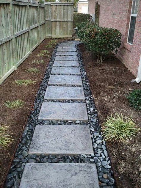 good solution for problem area: river rock and pavers More