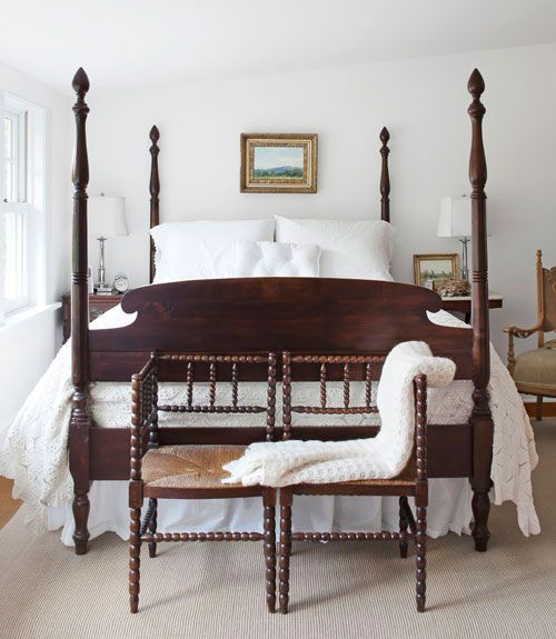 Their bedroom has a 1940s mahogany four-poster bed that Trina rescued from a friend's barn. The wood looks gorgeous against all the white.