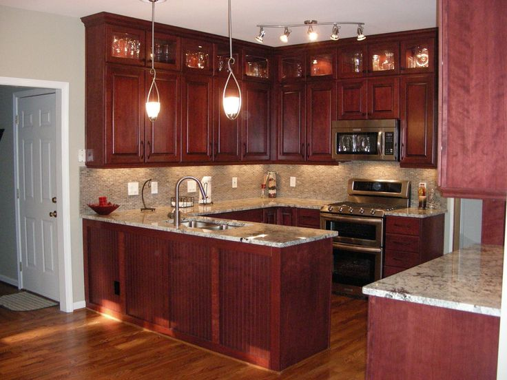 cherry kitchen cabinets with gray wall and quartz countertops ideas - Oak Kitchen Cabinets Ideas