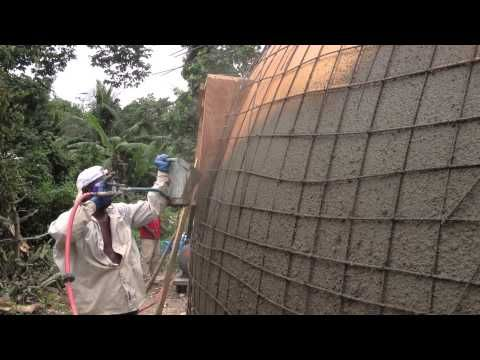 Monolithic Dome Construction | Ecoshell building at a Haiti H.E.R.O. outside Port au Prince. Dan Hildebrand of Hildebrand Construction with his local crew used a stucco sprayer to spray the shotcrete mix onto the ballon dome and construct this wonderful and safe dome community center/ disaster relief shelter.