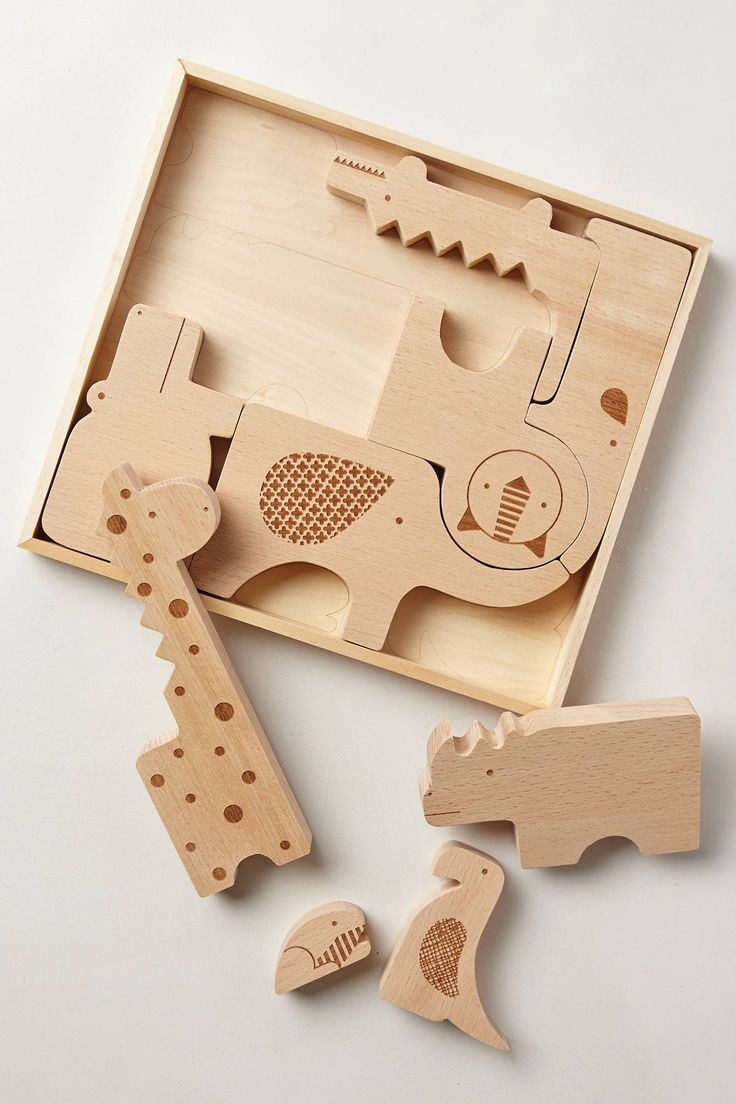 I think this would be fun for them to play with the animals and to put them back in the box. - Safari Jumble Puzzle from Anthropologie