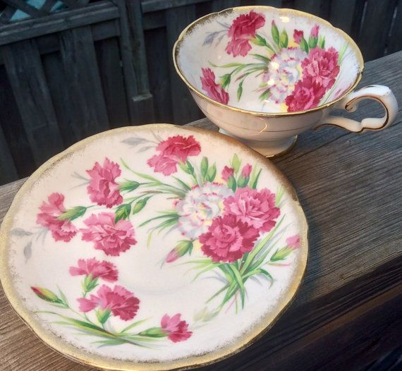 Absolutely gorgeous:Royal Stafford Carnation pattern Royal Stafford duo. Beautiful pink blooms abound on this lovely teacup and saucer, trimmed in gold. Excellent vintage condition. No chips, crazing or repairs. Please use the zoom feature to examine closely and request more photos if