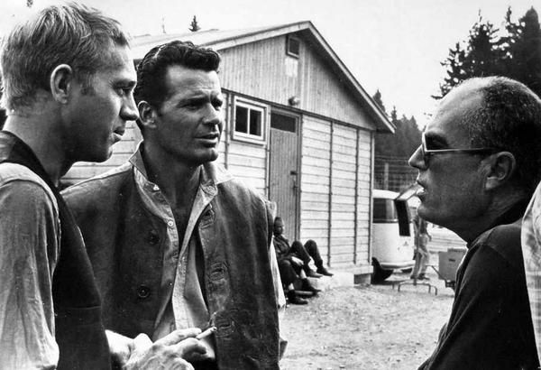 Steve McQueen, James Garner and director John Sturges discuss a scene in The Great Escape, 1963.