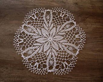 """This large white crochet doily entrances with its original pattern. It is very elegant so it will be ideal table decoration during important ceremonies. It will appeal to every lover of beautiful home decorations.  It can also be a gift.  This doily is a quite big, it is made of white mercerized cotton yarn.  Measurement: - Diameter - 16"""" (41 cm)"""