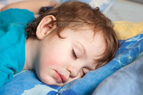 Child sleeping. http://photodune.net/item/child-sleeping/966725?WT.oss_phrase=toddler%20sleeping&WT.oss_rank=76&WT.z_author=ia_64&WT.ac=search_thumb
