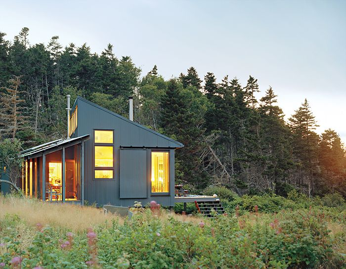 """The Porters' vision when creating the cabin was to build an """"unobtrusive abode that would blend with the local color"""", with a simple interior that could be made with local materials."""