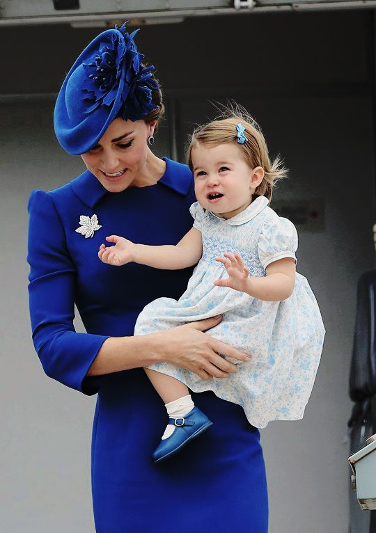 "duchesscambridges: "" ""Catherine, Duchess of Cambridge, carries her daughter, Princess Charlotte, as they arrive at Victoria Airport on September 24, 2016."" """