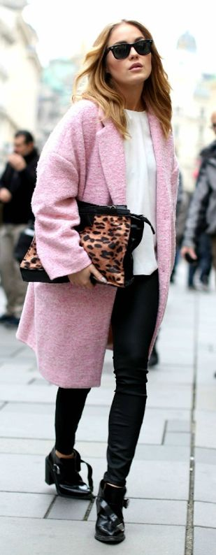 Angelica Blick is wearing a pastel pink oversized coat