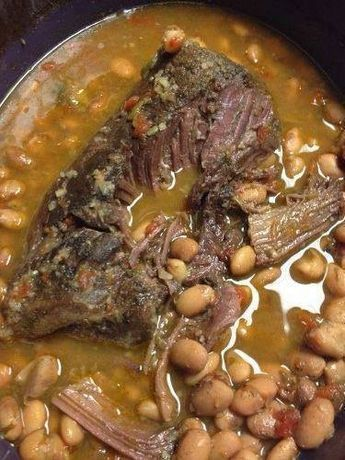 Roast- 2 lb. Pot Roast 2 Cups dry raw pinto beans 1 can of rotel or diced tomatoes 1 onion diced cumin (a dash or two) 1 tsp garlic powder 1 tsp chili powder 1 cup water Burritos- large tortillas shredded cheese salsa sour cream How to make it