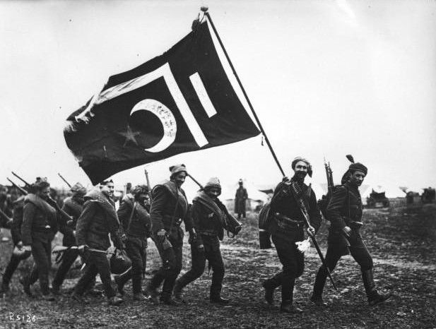 Ottoman troops with flag. This Day in History: May 30, 1913: The First Balkan War ends.