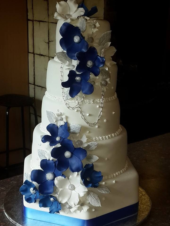 5 Tier white and blue wedding cake with hand made flowers by Altefyn Cakes