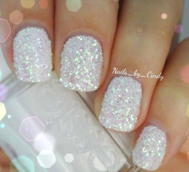 White glitter nail art is the ultimate glam choice for a fun beach wedding manicure or pedicure.