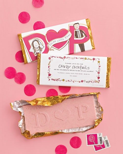 Strawberry chocolate bars from Chocolate Editions by Mary & Matt (chocolate-editions.com) were sent to guests as invites. Darcy's illustration (darcymillerdesigns.com) provides the details on the outside. Inside are the initials of Dylan and her fiance, Paul Arrouet. Custom stamps from Zazzle (zazzle.com) top it all off.