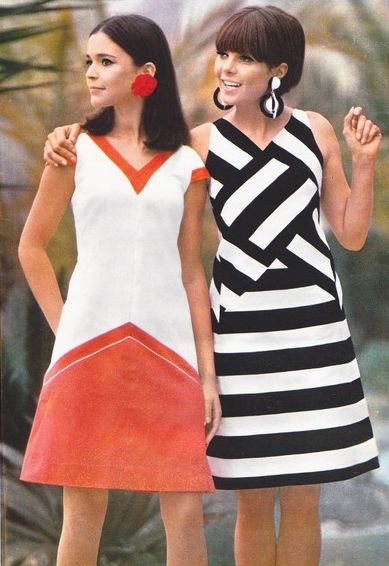 what makes this dress 60s fashion?  simple make up, short  dress, colour of the dress, short hair ..