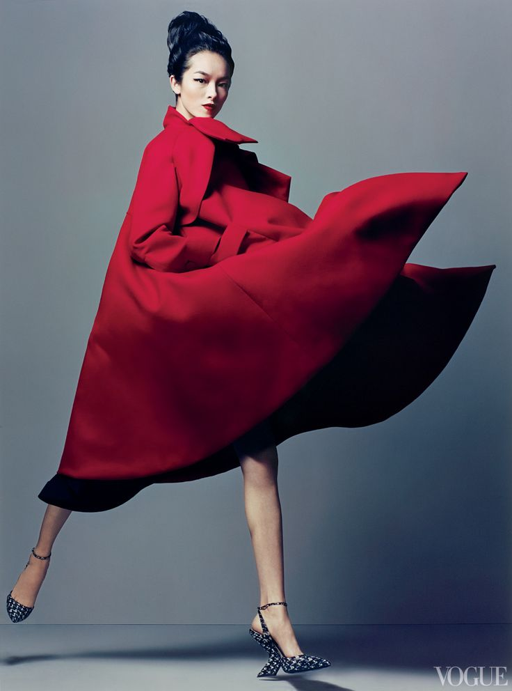 Christian Dior under Raf Simons is a house for sophisticates who know how to combine elegance with sharp modernity. Model Fei Fei Sun wears a signal-red coat that signals a fearless panache. Double-serge wool coat and snakeskin heels; Dior boutiques.