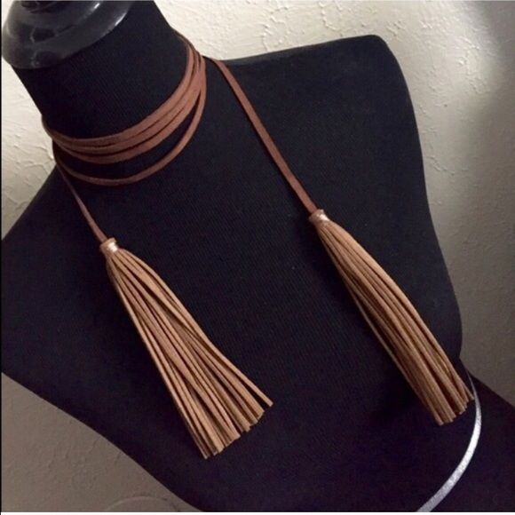 Faux Suede Tassel Necklace Single faux suede tassel ended string can be wrapped of unwrapped around neck as choker to adjust the level at which the tassels fall. Fashion jewelry. Brand new retail. No trades, no holding, no offsite payment. ALSO AVAILABLE in BLACK PRICE IS FIRM UNLESS BUNDLED No offers entertained for any reason Bundle and save Jewelry Necklaces