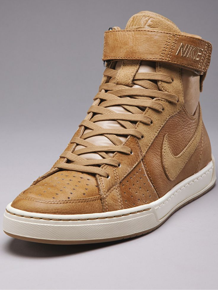 Tan leather Nike Air Flytops.