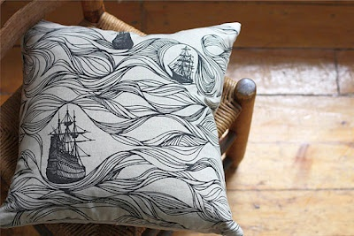 This ship pillow is made with an oatmeal colour linen  cotton and screen printed with a black hand drawn ships  and waves pattern. It has a feather insert and concealed  zipper along the bottom seam so the cover can be  removed and washed. You can also purchase  the pillow case without the insert  Jenna Rose Handmade, Etsy