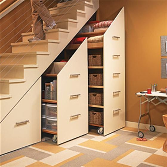 The cupboard under the stairs is given a modern makeover with clever sliding storage units.