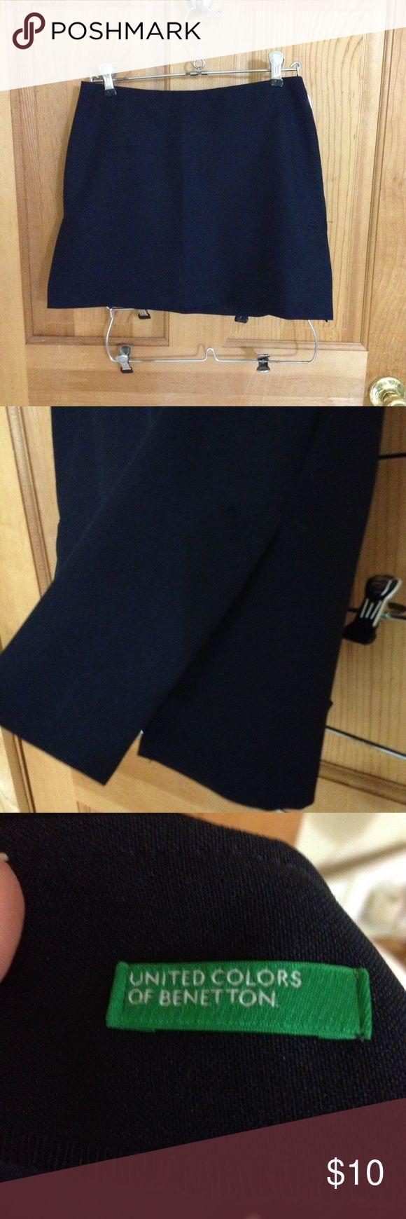Benetton black mini skirt Never worn sexy mini skirt with slits on both sides of skirt.  Zipper in back Benetton Skirts Mini