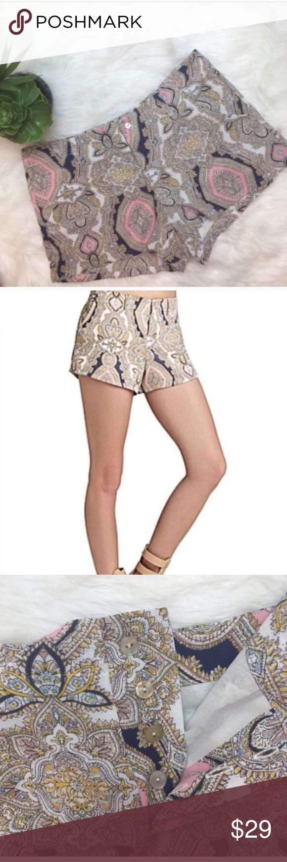 """BCBGENERATION Multicolored Paisley Shorts Pink yellow and navy paisley BCBGeneration shorts. Front pockets with row of hidden buttons. Cream lining inside. Waist 32""""  Inseam 2 6/8"""". In great condition! BCBGeneration Shorts"""