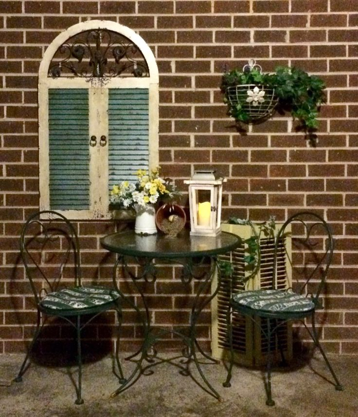 DIY carport sitting area. Who says you cant dress up brick?! Got everything from yard sales and Goodwill, and clearance broken and fixed it all up! Love it I do! Enjoyed putting it all together.