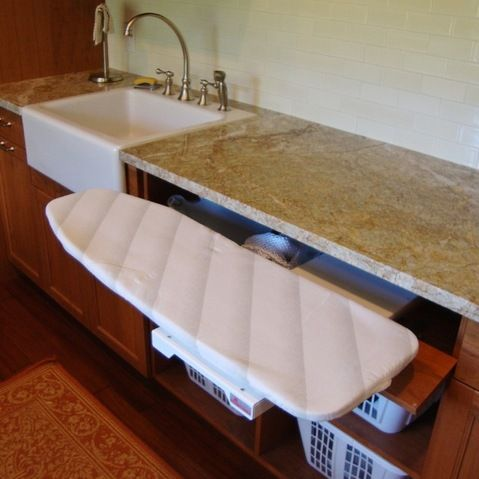 Built-in ironing board in the laundry room. How unique!