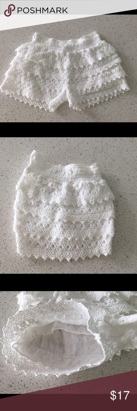 Juniors' Crochet Shortie Shorts With an eye-catching crocheted design, these juniors' shortie shorts define feminine style. Elastic waistband Crocheted design Scalloped hem Shorts