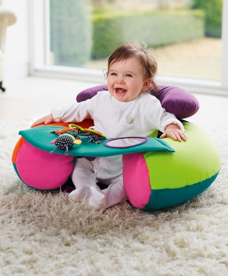The Mamas & Papas Sit and Play Babyplay Infant Positioner features bright colors, teethers, rattles, loops, play panel, mirror and more. This interactive baby activity toy helps stimulate and develop hand-eye coordination, visual, audio and tactile senses.
