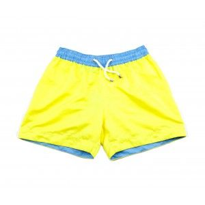 PACHA YELLOW SHORTS | The vibrant yellow swim shorts, 'Pacha', are named after the sexiest party club in Ibiza. Shop the collection at thomasroyall.com