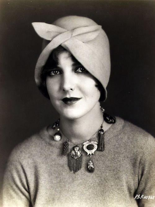 Jean Arthur, looking darling in a cloche and 'charm necklace' (circa 1920s)