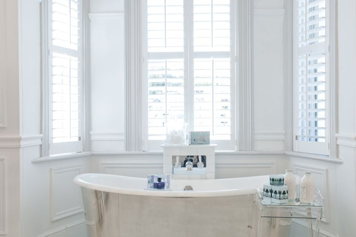 The Bateau bath in a polished pewter skirt with the St James bath filler.