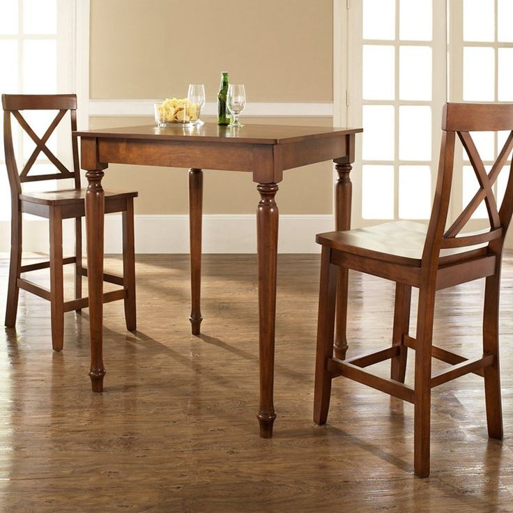 Have to have it. Crosley 3-Piece Pub Dining Set with Turned Leg and X-Back Stools - $329 @hayneedle