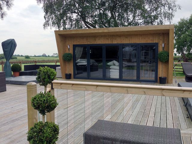 this is a large garden room by green retreats has got indoor