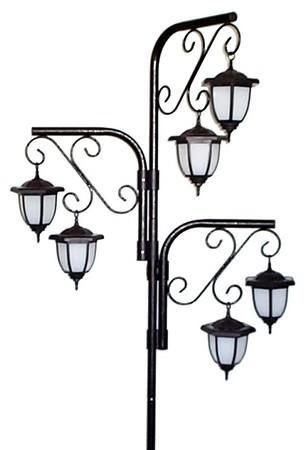 solar lights on hanging flower post...love this idea