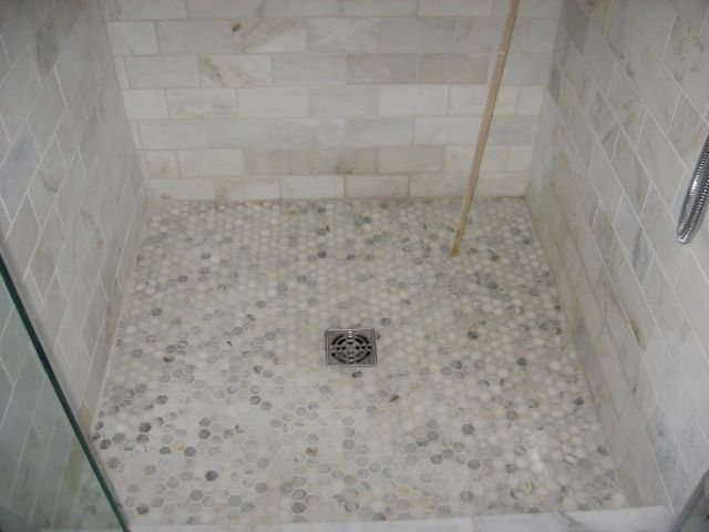 White Carrara Marble Shower With Pebble Flooring