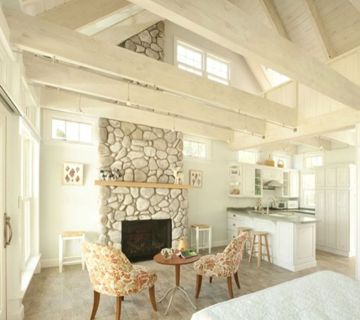 The stonework in the fireplace juxtaposed to the whitewashed walls is gorgeous
