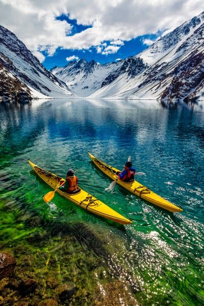 James Heim and Michelle Parker using Kayaks to access skiing ~ on Laguna de Incas in Portillo, Chile.