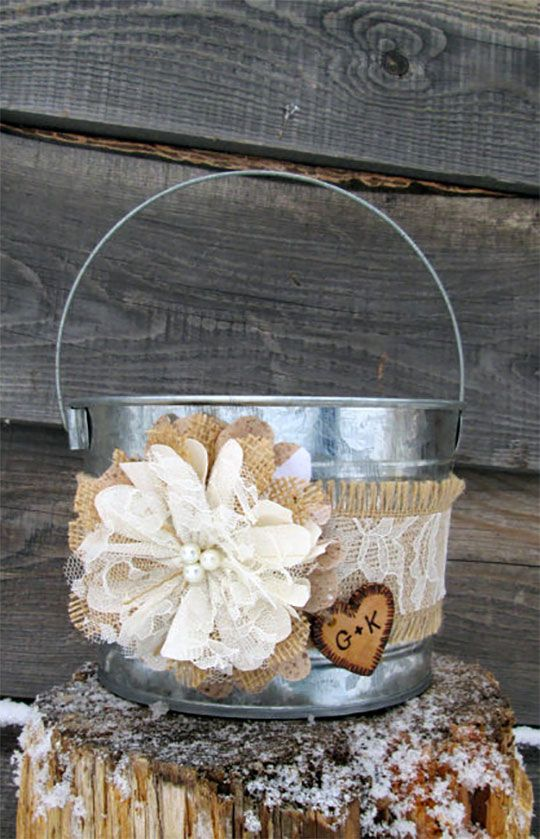 This personalized rustic lace and burlap basket is actually a bucket. Could be a flower girl basket, centerpieces, or program holder. Scroll to number 10 on the page.