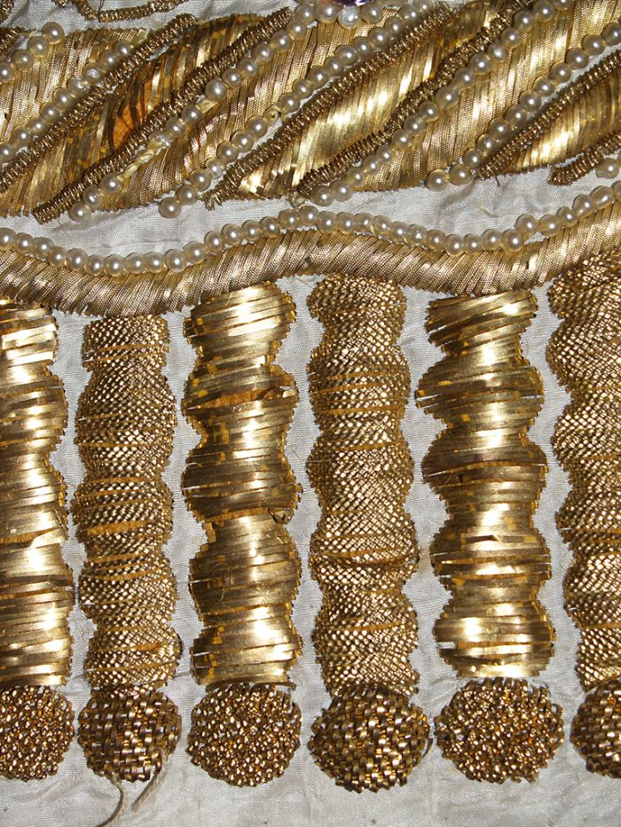 Detail of gold embroidery on ca. 1815 evening dress, KSUM 1987.97.28. Collection of the Kent State University Museum.