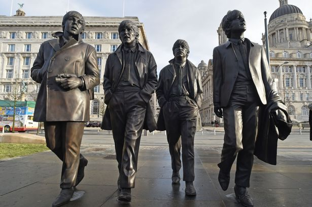 The Beatles statue unveiled at the Pier Head, Liverpool. John Lennon's sister Julia Baird officially unveils latest tribute to The Beatles.