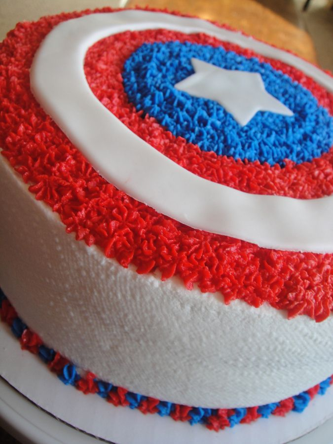 For a little boys 4th Birthday superhero party. Too fun!  Chocolate cake, chocolate/fudge/oreo filling, bc frosting