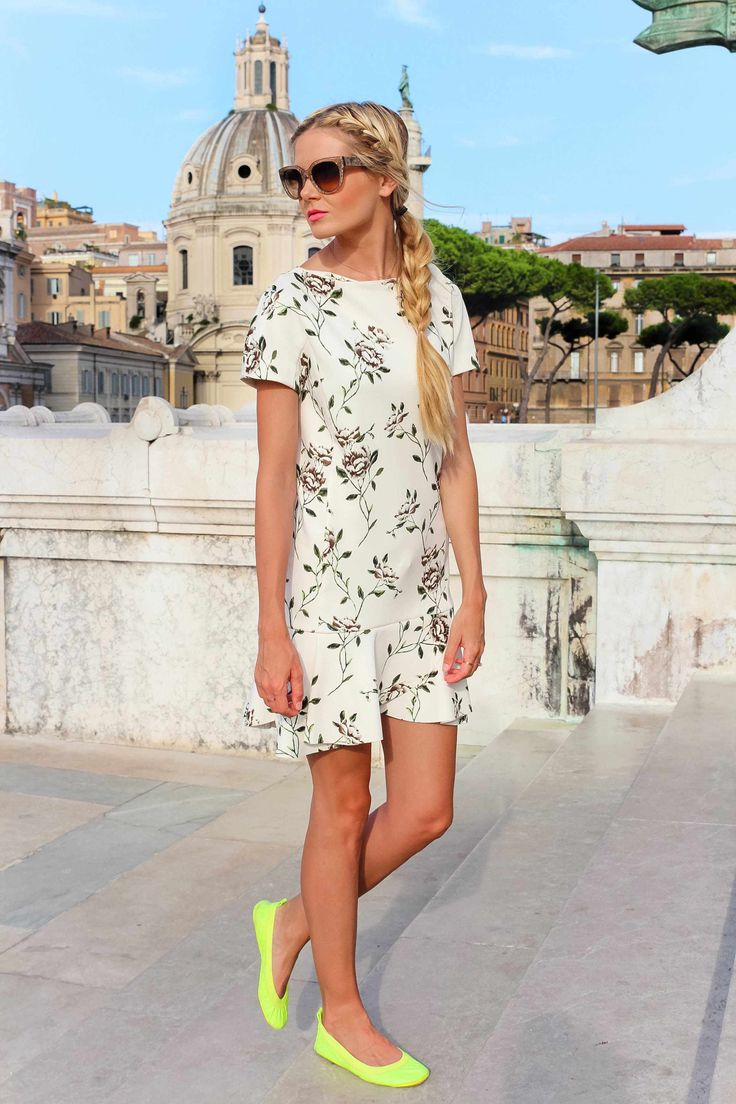 Obsessed with everything from the hair to the dress to the neon flats!