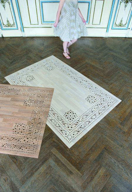 Cheap vinyl flooring becomes decorative rug
