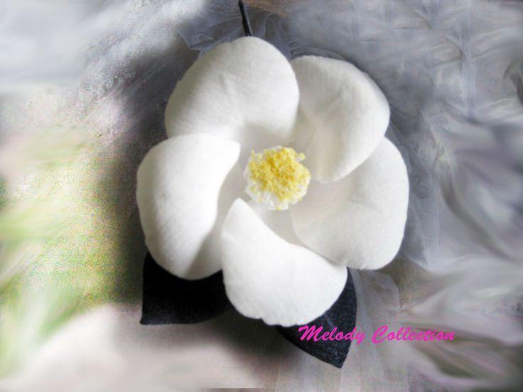 white camellia made by white velvet.