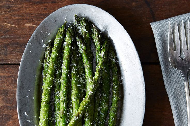 Asparagus with Spring Garlic Pesto - This simple salad packs a punch of garlicky flavor, and it's good warm or chilled. Skip the sprinkle of Parm at the end.