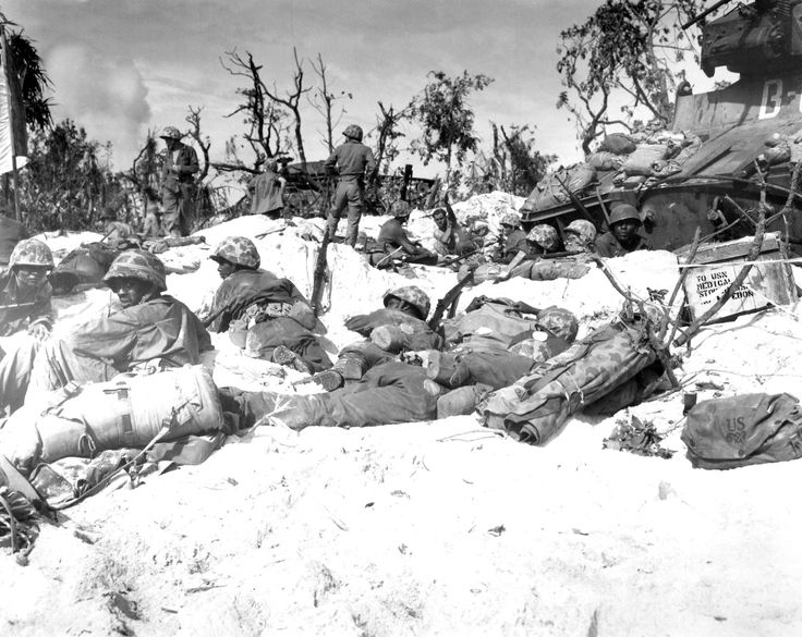 U.S. Marines of the 1st Marine Division move through the sand to try to establish a beachhead during the first day of the Battle of Peleliu, Operation Stalemate II.