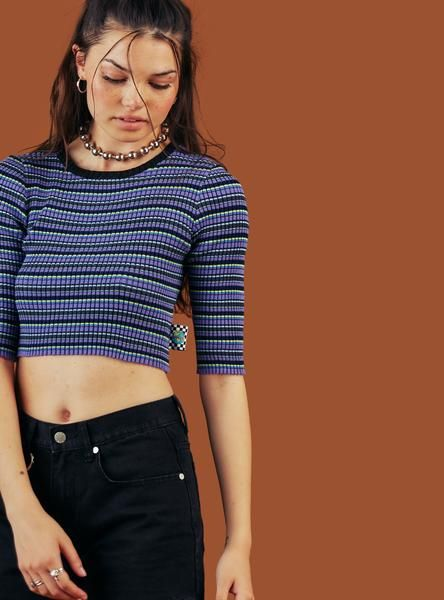 Striped, cross ribbed crop-top with cropped 1/2 sleeve and flag tag at side hem. Materialhas a bit of stretch and runs true. Comes in multiple colorways. 10