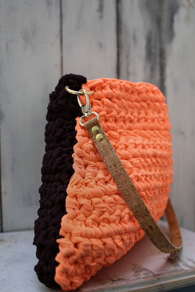 Orange and dark purple. Cool and modern triangle shaped bag dressed in warm orange and dark purple colors. The long and elegant strap is made by natural cork with gold details. It's length is adjustable with gilded metal fastener. Height 32cm Length (bottom) 41cm Price: 160