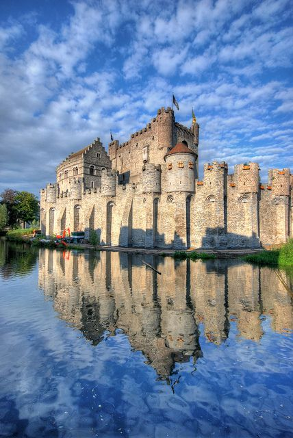 This is gorgeous photograph of medieval Gravensteen Castle in Belgium. Great composition, great timing, wonderful color. The reflection works out for above average effect.